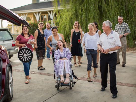 "Betsy Davis, in the final stages of ALS, in July invited dozens of friends to join her at a ""rebirth"" party. Later that day, a care provider helped her hold a cup to ingest a toxic concoction of drugs that killed her. (Photo: Niels Alpert/Special to The Register)"
